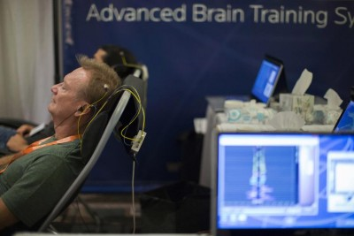 Man receiving NeurOptimal Brain Training session at Bulletproof conference in California (see article link)